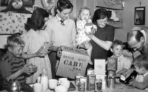 A CARE assistant for England and Wales delivers a package to a family in 1948 Photo CARE